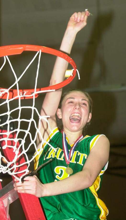 Trinity Catholic's Amanda Pape celebrates the Crusaders' 2002 Class S championship. Pape will be inducted into the Connecticut Women's Basketball Hall of Fame Wednesday. Photo: KATHLEEN O'ROURKE, ST / SCNI