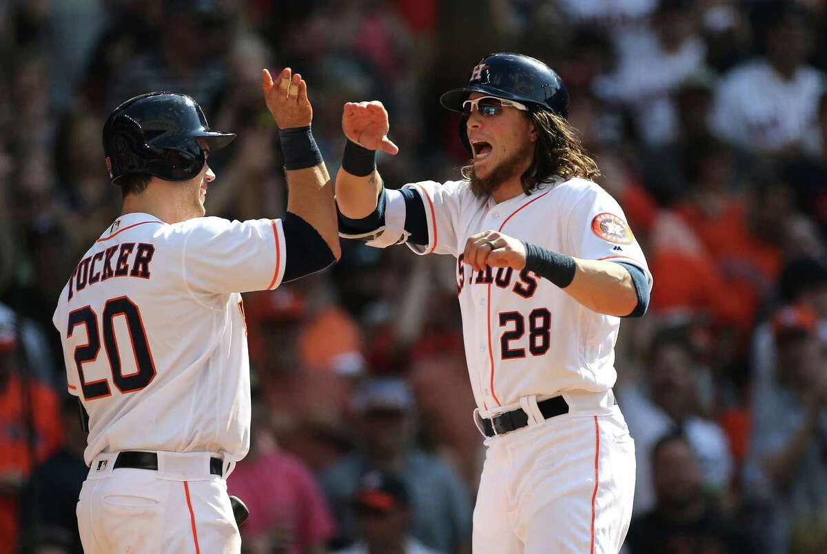 Houston Astros designated hitter Preston Tucker (20) congratulates Houston Astros left fielder Colby Rasmus (28) after his grand slam home run in the fifth inning Houston Astros game against the Boston Red Sox on Saturday, April 23, 2016, in Houston.