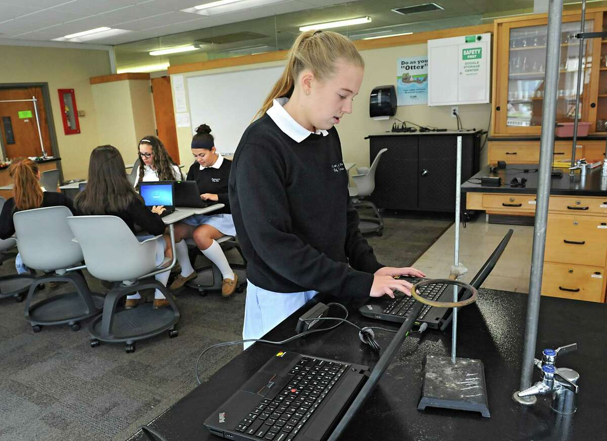 Ninth grader Brianna Hoffman, center, along with other classmates, works on a computer in the chemistry lab at Academy of the Holy Names on Friday, May 6, 2016 in Albany, N.Y. The all-girls Catholic school dating back to 1884, will close its lower school (P-5) at the end of the school year due to declining enrollment. It will refocus its resources and energy on the upper school (6-12). (Lori Van Buren / Times Union)