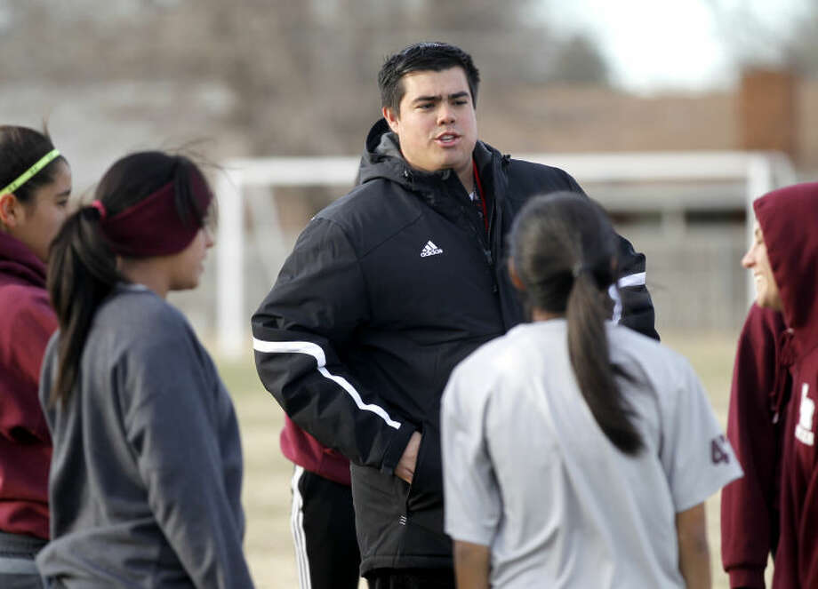 Lee girls soccer head coach Alan Castillejos talks to his team during practice during this 2014 file photo at Lee. James Durbin/Reporter-Telegram
