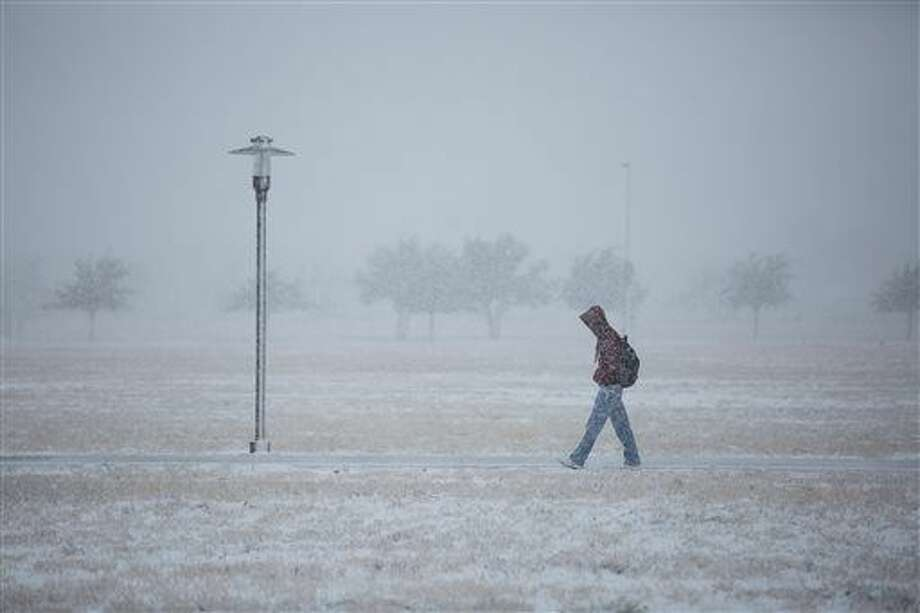 """Days after the warmest November on record at Midland International, there is a chance of a """"wintry mix,"""" according to the National Weather Service. Photo: (AP Photo/Odessa American,  Courtney Sacco)"""
