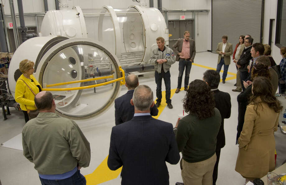 FILE PHOTO: Dennis Gilliam with Orbital Outfitters, talks about the new pressure chambers as members of the MDC board tour the Orbital Outfittes facility Friday 01-29-16, watching a demonstration of the pressure chamber and the affect on water in a low pressure atmosphere. The MDC voted unanimously to terminate its agreement with Orbital Outfitters, a space suit startup company headquartered at Midland International Air & Space Port.  Photo: Tim Fischer