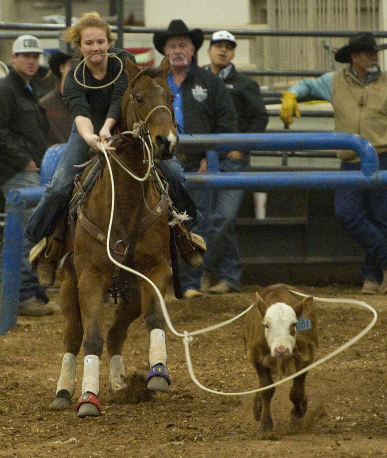 Destiny Hatfield chases down her calf Saturday 01-02-16 at the Tall City New Year's Calf-Roping Blowout at the Horseshoe Arena. Tim Fischer\Reporter-Telegram Photo: Tim Fischer