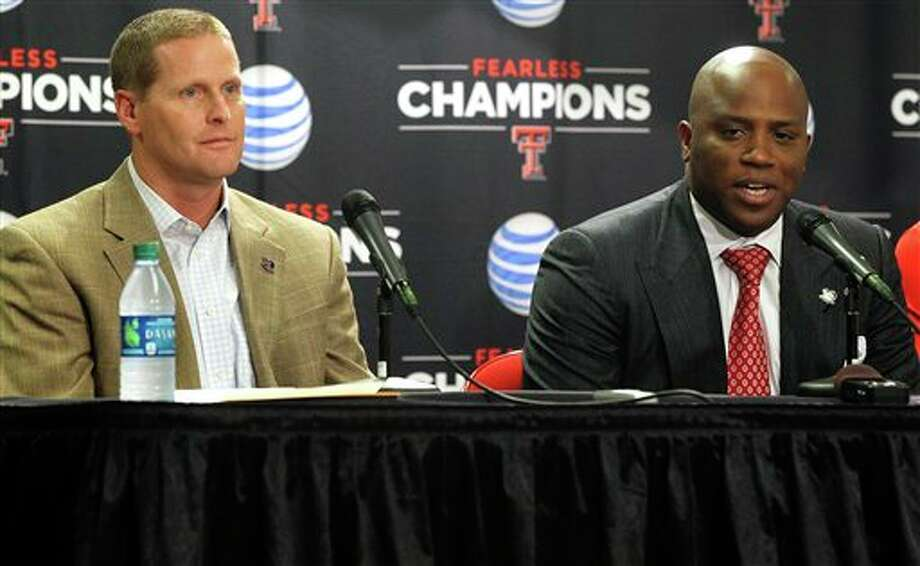 Texas Tech interim head coach Chris Walker, right, speaks next to athletic director Kirby Hocutt during an NCAA college basketball news conference in Lubbock, Texas, Thursday, Oct. 4, 2012. (AP Photo/The Avalanche-Journal, Zach Long) ALL LOCAL TV OUT Photo: Zach Long / The Avalanche-Journal