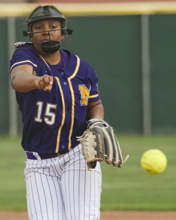 Midland High starting pitcher Deandra Allen tosses one in Tuesday 03-08-16 against Odessa High at Audrey Gill Sports Complex. Tim Fischer\Reporter-Telegram