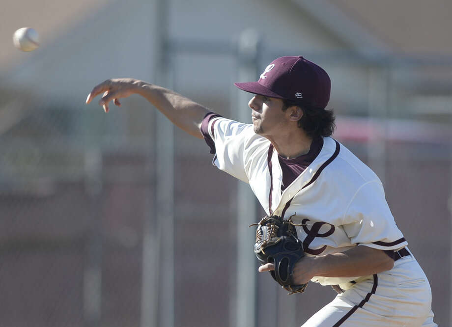 Lee pitcher Evan Mata (1) throws against Odessa on Tuesday, March 15, 2016, at Ernie Johnson Field. James Durbin/Reporter-Telegram