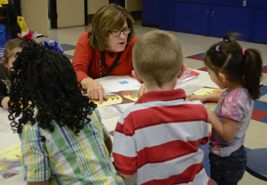 "School board member Karen Nicholson was among volunteers with United Way and Women's Leadership Council who read to students at Crockett Elementary during the 2013-14 school year as part of the Ready to Read program. Crockett is one of nine Midland ISD campuses on  Texas Education Agency's ""improvement required"" list. Crockett is on for the sixth straight year."