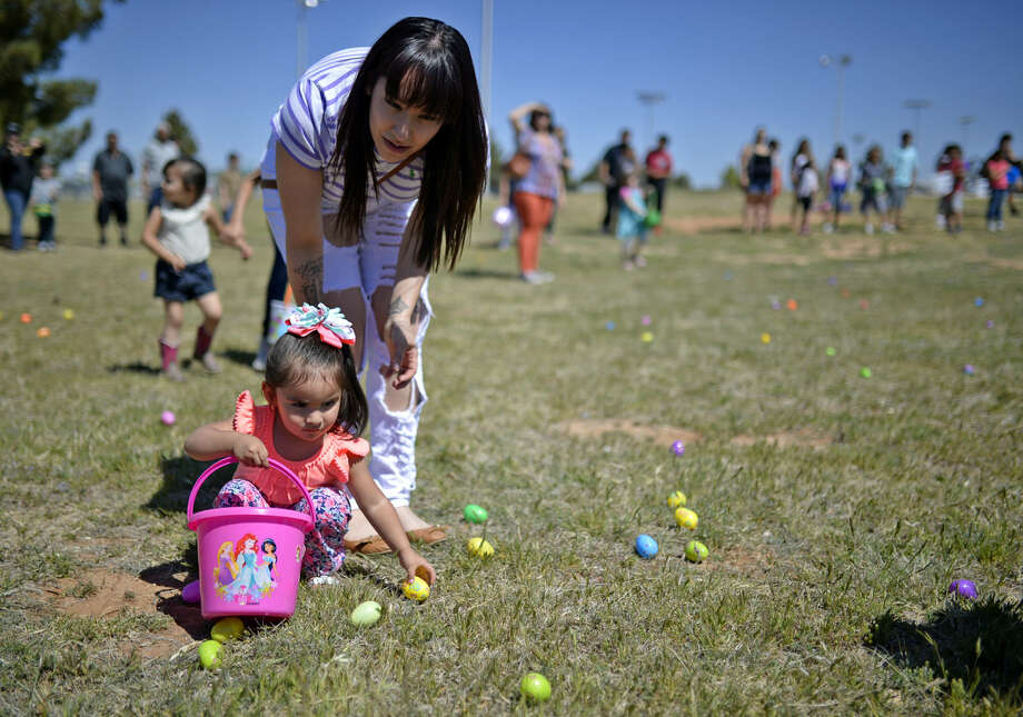 Victoria Lopez helps her 2-year-old daughter Amaya hunt for easter eggs during the annual 2016 Easter Bash car show Saturday, March 26, 2016, at Beal Park. James Durbin/Reporter-Telegram Photo: James Durbin