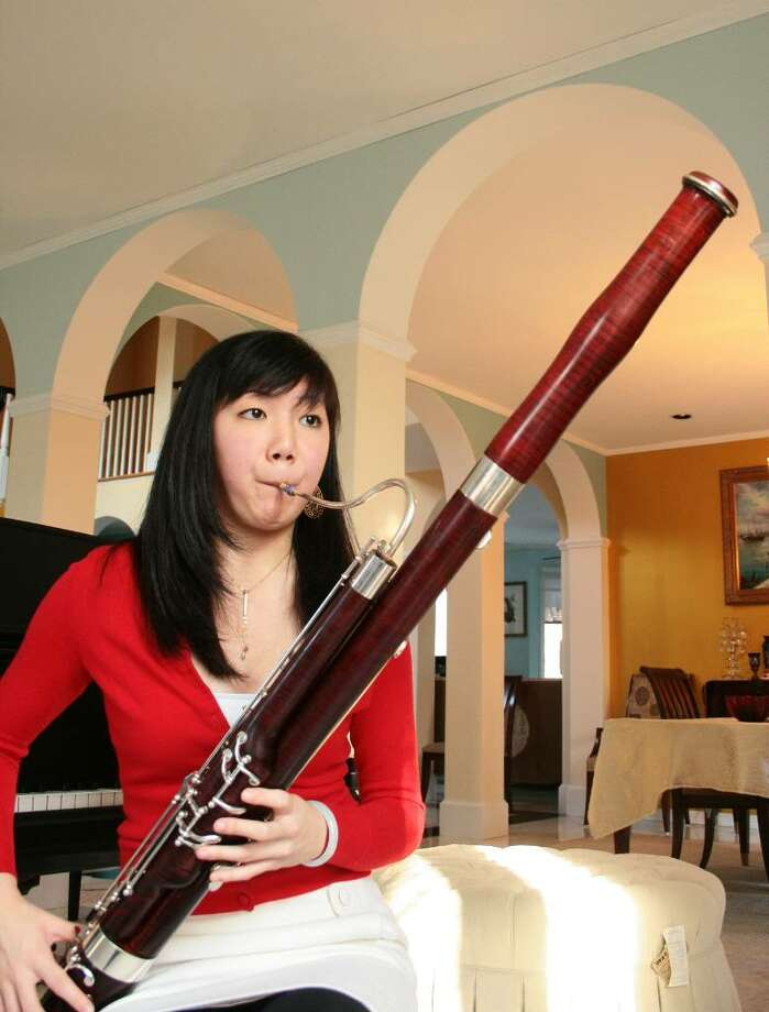 "Catherine Chen, a senior at Greenwich High School shown practicing on the bassoon, performs with ""The President's Own"" U.S. Marine Band Sunday in Washington, D.C. Photo: Contributed Photo, Greenwich Time / Greenwich Time Contributed"