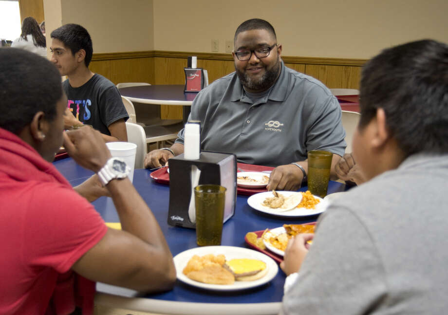 Karl Boroski, executive director of ROPE Youth, has lunch with Lee High School students on April 14, 2016, at the Midland College cafeteria. Boroski recently helped raise funds to pay off lunch debt at 10 Midland ISD schools. Photo: Tim Fischer