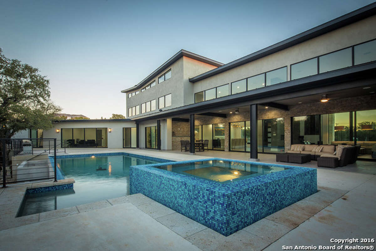 One of the home's main features is its in-ground heated pool and matching hot tub.