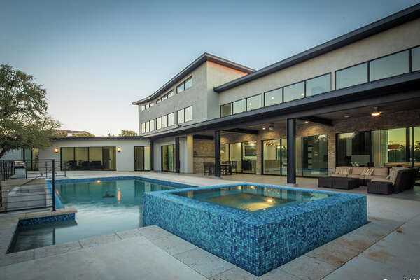 This contemporary home in Stone Oak is on the market at $1.4 million. Located at  44 Tramore , the house spans 7,951 square feet and holds six bedrooms, seven full bathrooms, a pool, spa and maids' quarters.