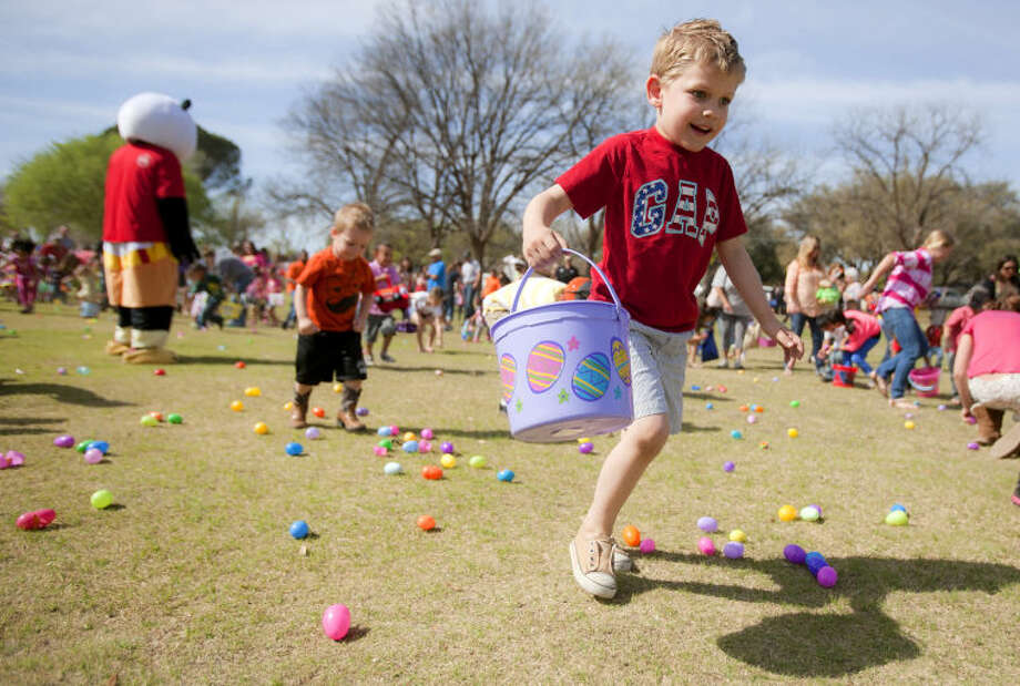 Jason Bennett, age 5, participates in the fourth annual Easter Eggstravaganza easter egg hunt sponsored by First Christian Church on Saturday at Hill Park. James Durbin/Reporter-Telegram Photo: JAMES DURBIN
