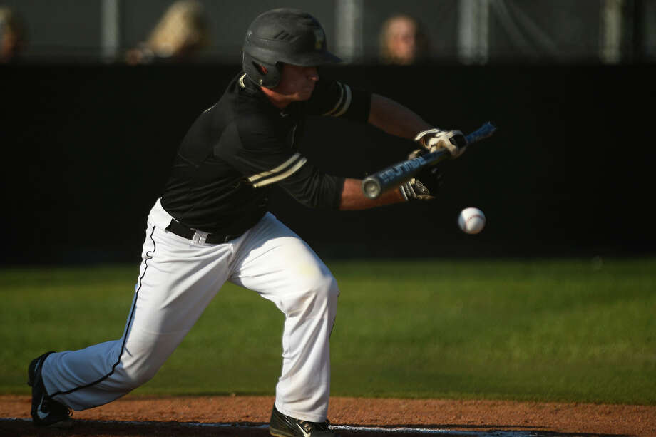 Vidor's Blake Robinson bunts against Barbers Hill in the first game of a best-of-three class 5A bi-district playoff series on Friday night.  Photo taken Friday 5/6/16 Ryan Pelham/The Enterprise Photo: Ryan Pelham / ©2016 The Beaumont Enterprise/Ryan Pelham