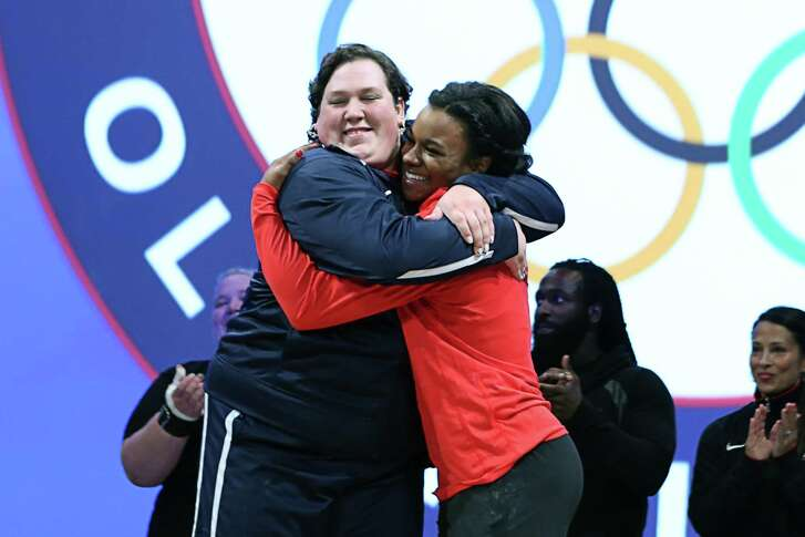SALT LAKE CITY, UT - MAY 08:  (L - R) Sara Robles and Jenny Arthur hug after being named to the 2016 USA Olympic Team at the USA Olympic Team Trials for weightlifting at the Calvin L. Rampton Convention Center on May 8, 2016 in Salt Lake City, Utah.  (Photo by Melissa Majchrzak/Getty Images)