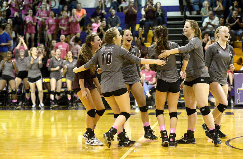 Lee High volleyball players celebrate after scoring against Midland High on Tuesday, Oct. 20, 2015, at Midland High. James Durbin/Reporter-Telegram Photo: James Durbin