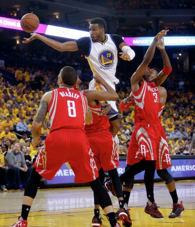 Golden State Warriors' Leandro Barbosa passes while being fouled by Houston Rockets' Jason Terry in 2nd quarter during Warriors' 115-106 win in Game 2 of 1st round of NBA Playoffs at Oracle Arena in Oakland, Calif., on Monday, April 18, 2016. Photo: Scott Strazzante, The Chronicle / ONLINE_YES