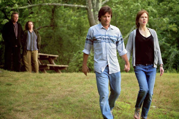 """This image released by Starz Digital shows Jason Bateman and Nicole Kidman, right, in a scene from """"The Family Fang."""" (Starz Digital via AP)"""