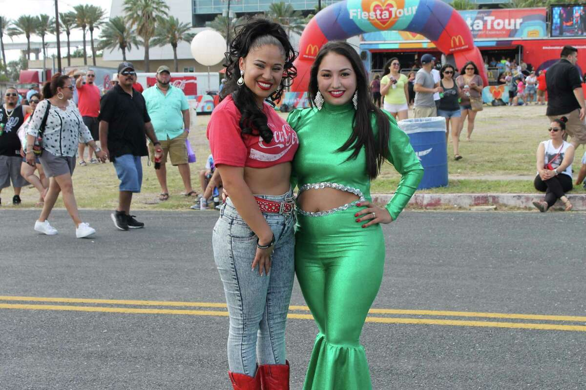Houston's Amanda Solis, a Selena Quintanilla tribute act, attends the Fiesta de la Flor in Corpus Christi, where she was approached by lots of fans for photos. Solis performs around Houston and is working toward original material. She bears an uncanny resemblance to the Tejano icon.