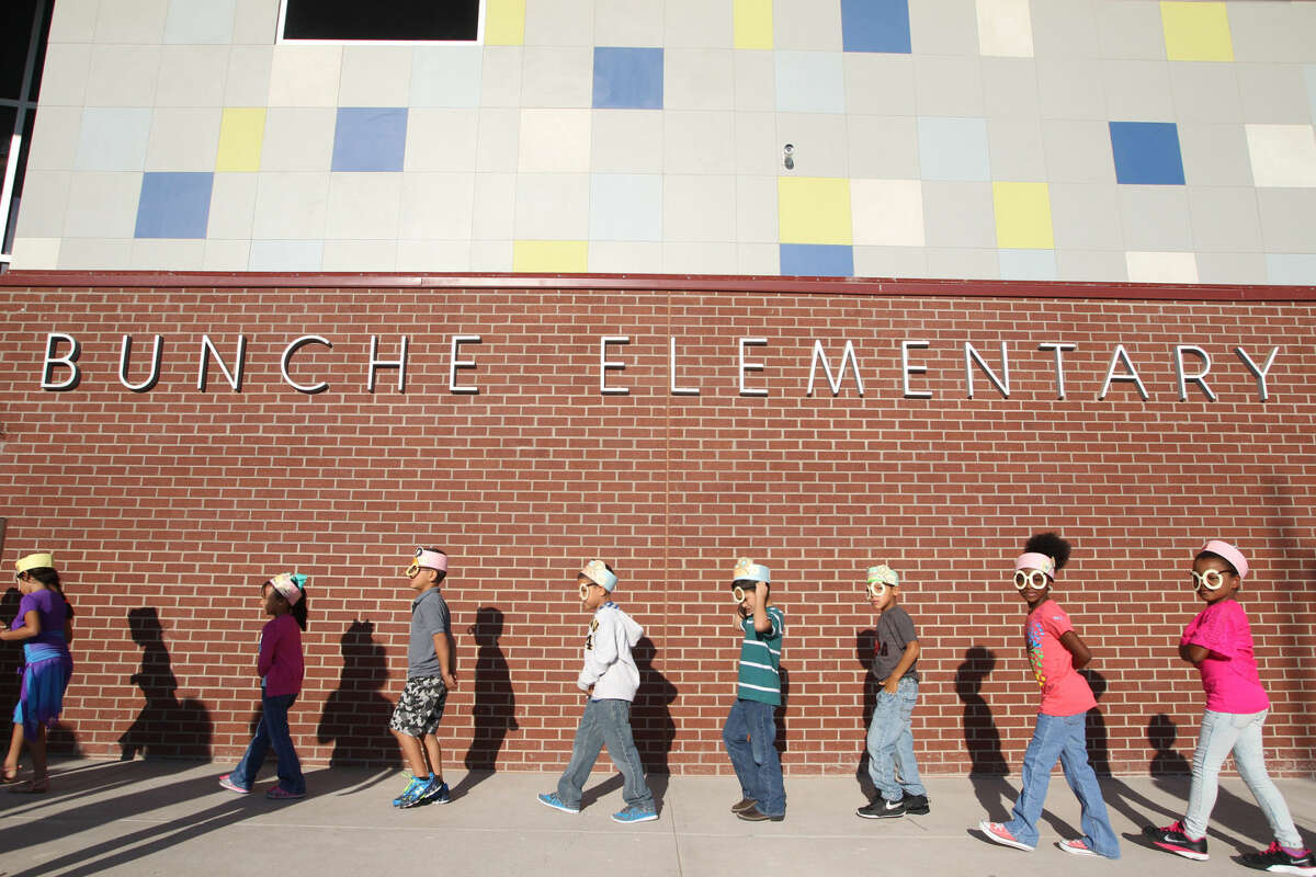 """Bunche Elementary students await the arrival of author of Marc Brown during Project Literacy on Sept. 14, 2015. Bunche is one of six Midland ISD elementary schools that are facing a """"critical"""" point in terms of enrollment."""