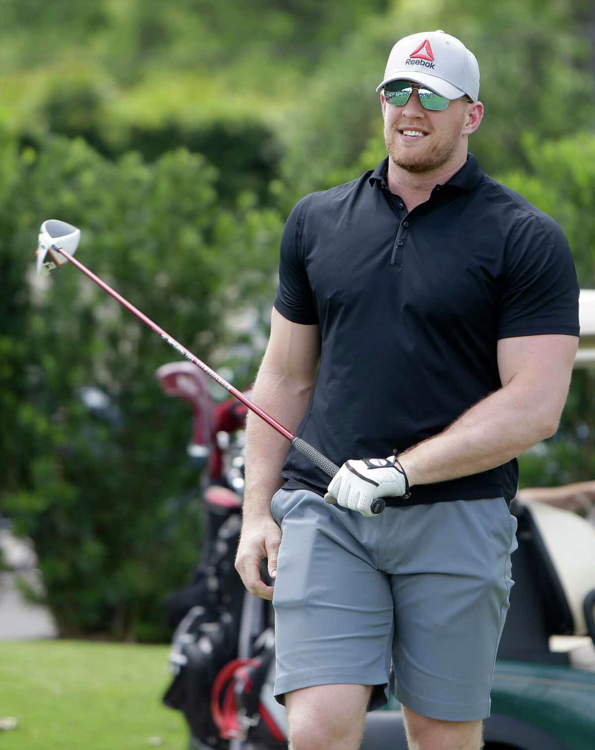 Texans J.J. Watt prepares to tee off during the Texans charity golf tournament at River Oaks Country Club, 1600 River Oaks Blvd., Monday, May 9, 2016, in Houston.