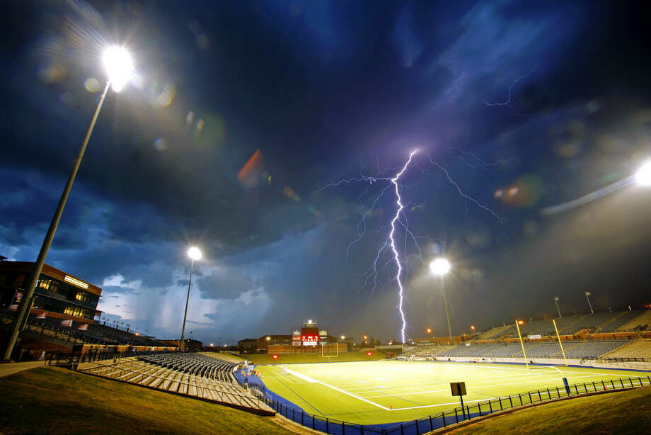 Lightning strikes over Grande Communicatons Stadium as weather delays Lee High's homecoming game against El Paso El Dorado on Friday, Sept. 18, 2015. James Durbin/Reporter-Telegram