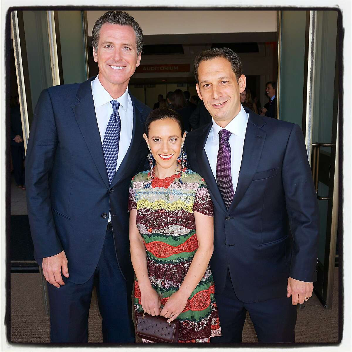 Lt. Gov. Gavin Newsom (left), Becca Prowda and her husband, Tipping Point founder-CEO Daniel Lurie at Bill Graham Civic Auditorium. May 2016.