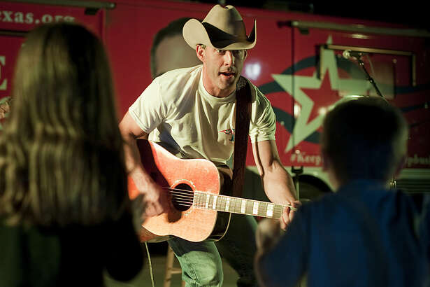 Aaron Watson sings to Aley and Owen Carter Tuesday evening during a free show as he helps George P. Bus campaign for Texas Land Commissioner. Tim Fischer\Reporter-Telegram