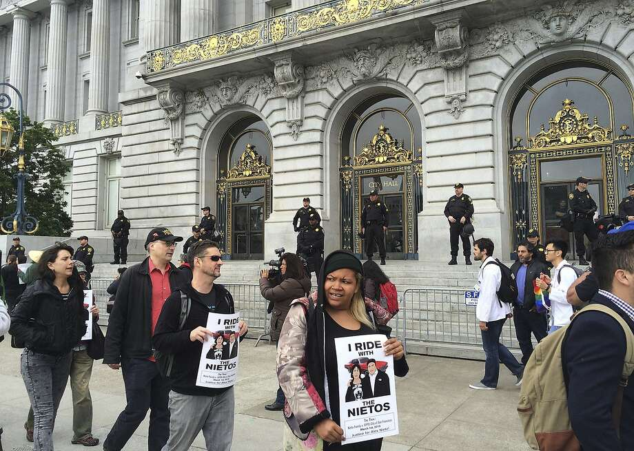 Dozens of people protest outside City Hall in their continued push for the removal of police chief Greg Suhr in San Francisco, Monday, May 9, 2016. Five activists who refused to eat for 17 days, along with their supporters, are holding a peaceful protest at City Hall. The five ended their hunger strike Saturday after they were taken to the hospital. A protest organizer announced at the protest that most of the five will start eating solid food again Monday. (AP Photo/Janie Har) Photo: Janie Har, Associated Press
