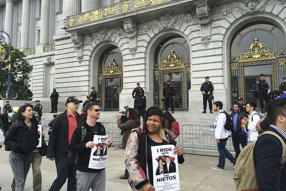 Dozens of people protest outside City Hall in their continued push for the removal of police chief Greg Suhr in San Francisco, Monday, May 9, 2016. Five activists who refused to eat for 17 days, along with their supporters, are holding a peaceful protest at City Hall. The five ended their hunger strike Saturday after they were taken to the hospital. A protest organizer announced at the protest that most of the five will start eating solid food again Monday. (AP Photo/Janie Har)