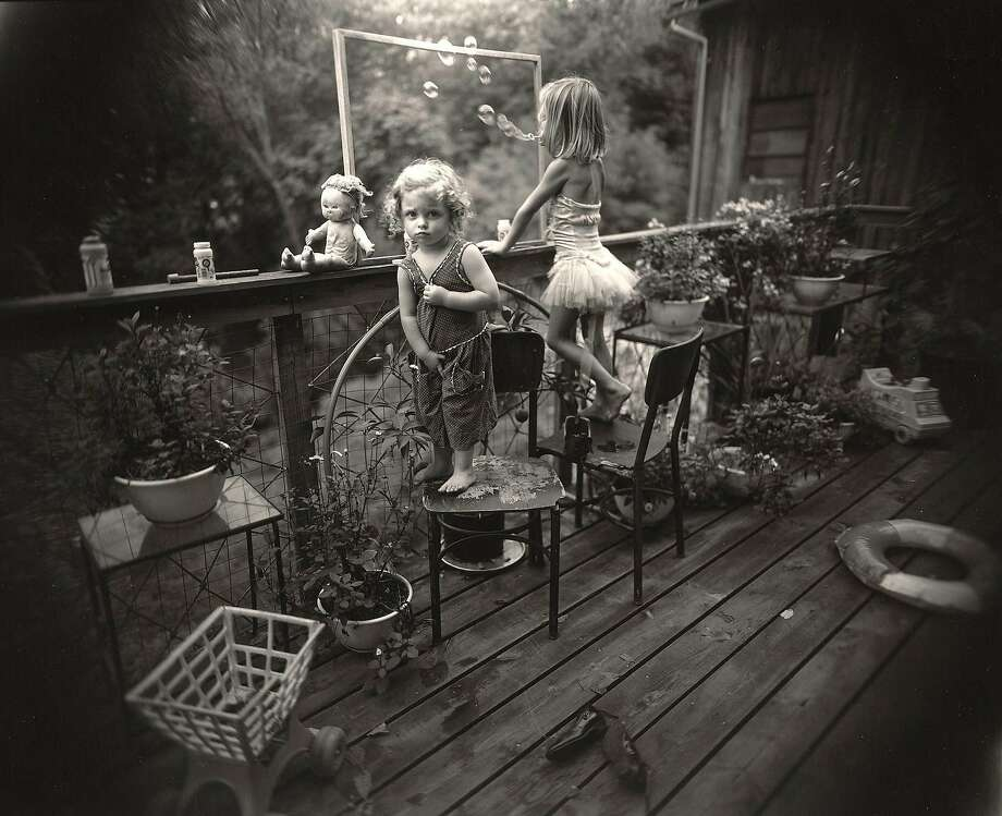 """Blowing Bubbles,"" 1987, from Sally Mann's ""Immediate Family"" series, gelatin silver enlargement print, is on view at Jenkins Johnson Gallery. Photo: � Sally Mann. Courtesy Jenkins Johnson Gallery."