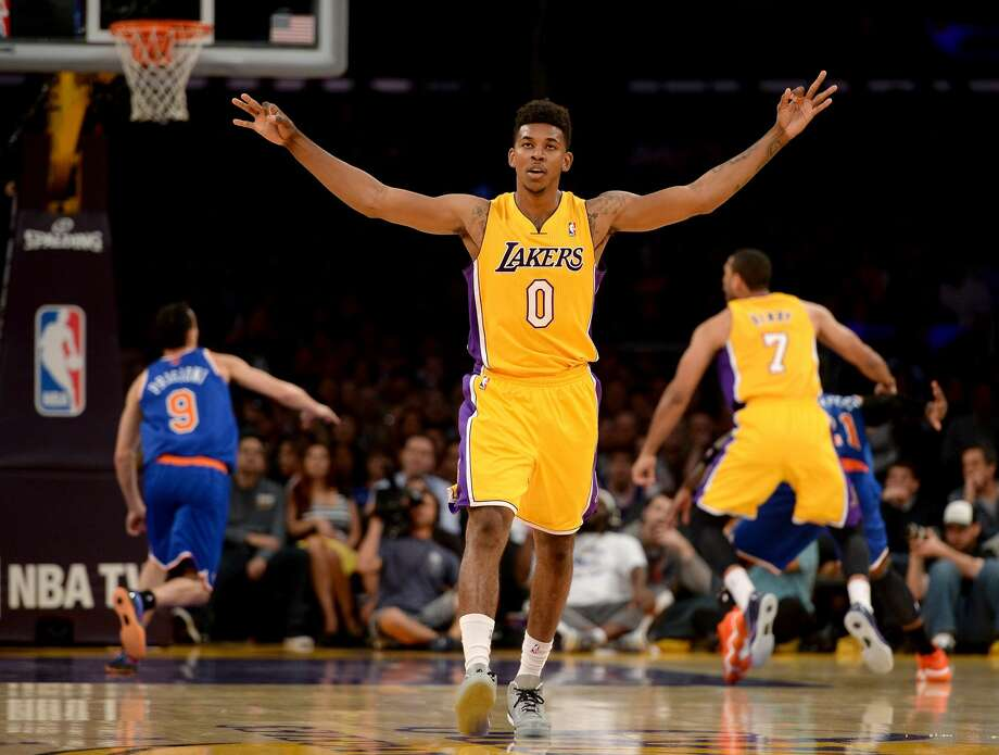 25. Nick Young, LakersPlayer value index: 34.6In this photo, the Lakers shooting guard is celebrating. That must be good, right? Wrong. Young turned around to celebrate as soon as he let go of that shot, but it missed.