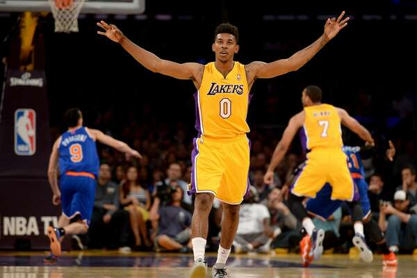 LOS ANGELES, CA - MARCH 25:  Nick Young #0 of the Los Angeles Lakers reacts after his shot during the game against the New York Knicks at Staples Center on March 25, 2014 in Los Angeles, California.   NOTE TO USER: User expressly acknowledges and agrees that, by downloading and or using this Photograph, user is consenting to the terms and condition of the Getty Images License Agreement.  (Photo by Harry How/Getty Images)