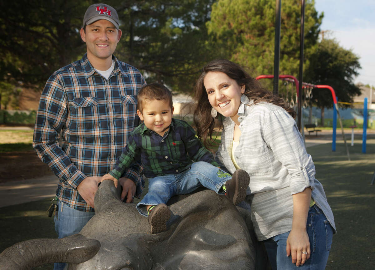 Monica Hernandez poses for a photo with her family, Rigo and Isaac, age 2, while playing in Opportunity Park in this 2014 file photo.