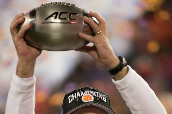 Clemson head coach Dabo Swinney hoists the ACC Championship trophy after the Tigers' 45-37 victory against North Carolina at Bank of America Stadium in Charlotte, N.C., on Saturday, Dec. 5, 2015. (Robert Willett/Raleigh News & Observer/TNS)