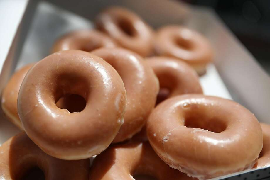 MIAMI, FL - MAY 09:  In this photo illustration, Krispy Kreme Donuts are seen on May 09, 2016 in Miami, Florida.  JAB Holdings Company, announced it is acquiring Krispy Kreme Donuts in a deal valued at $1.35 billion.  (Photo illustration by Joe Raedle/Getty Images) Photo: Joe Raedle, Getty Images
