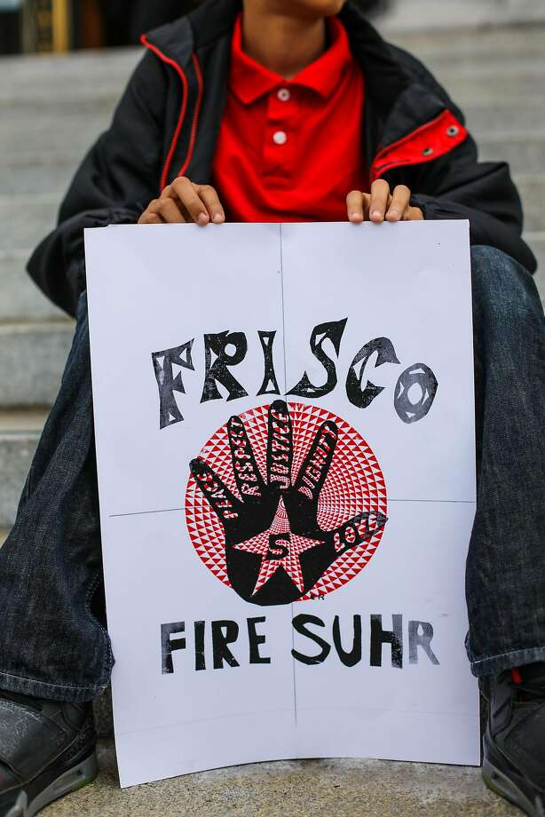 Isaiah Sanabria, 13, rested on the steps of City Hall as he held a sign in solidarity with the group the Frisco Five, during a protest against racism, police brutality and for the firing of police chief Greg Suhr, in San Francisco, California, on Monday, May 9, 2016. Photo: Gabrielle Lurie, Special To The Chronicle