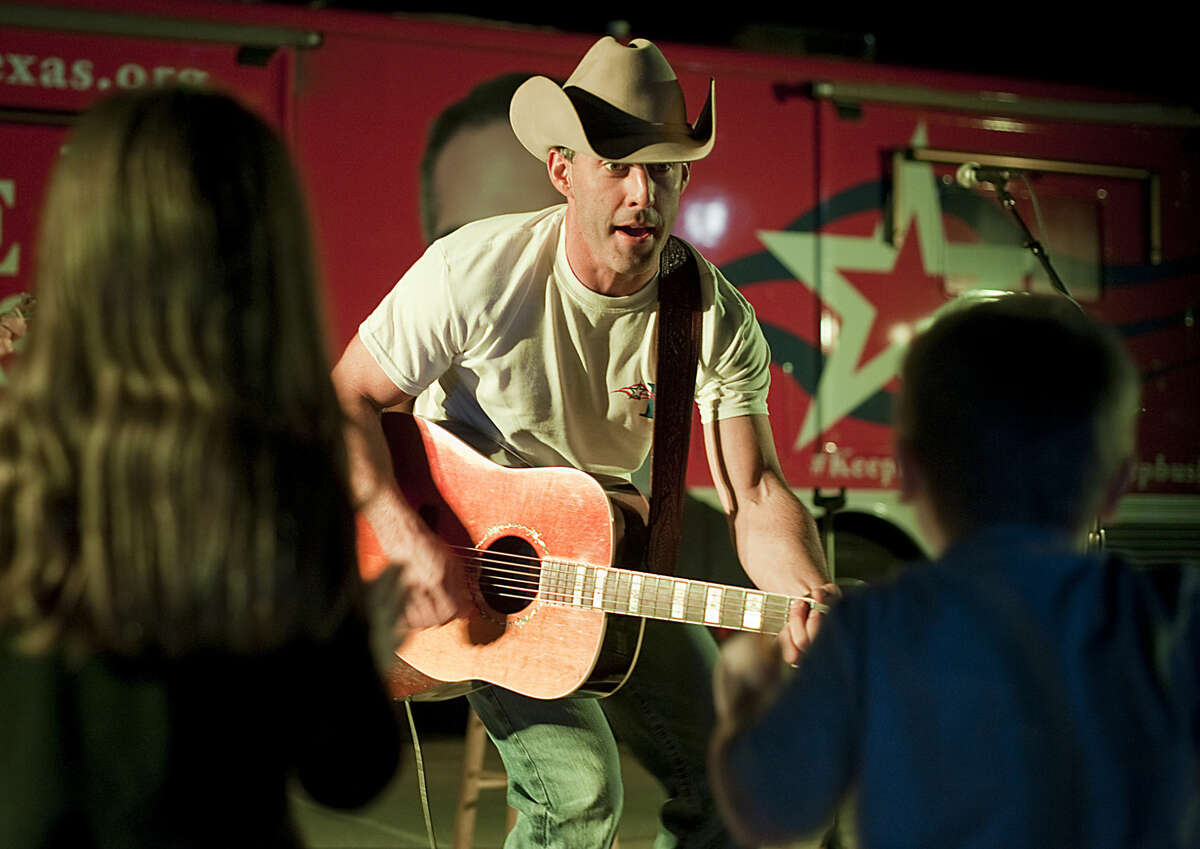 Aaron Watson sings to Aley and Owen Carter during a free show as he helped George P. Bush campaign for Texas Land Commissioner in this Reporter-Telegram file photo.