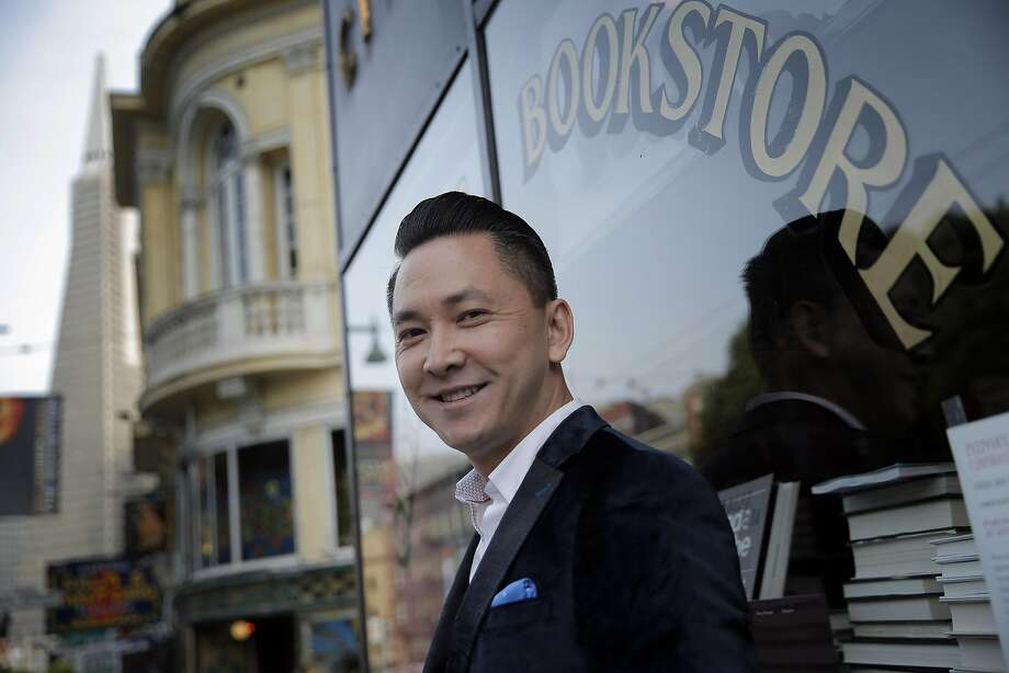 """Viet Thanh Nguyen at City Lights: """"The work of witnesses remains important,"""" he says of the new book he has edited, """"The Displaced: Refugee Writers on Refugee Lives."""" Photo: Carlos Avila Gonzalez / The Chronicle"""