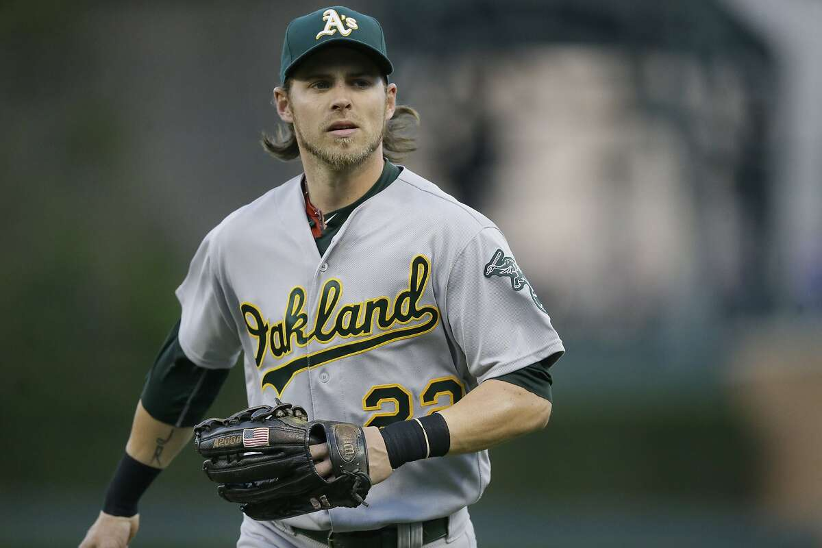 Oakland Athletics right fielder Josh Reddick runs to the dugout during the second inning of a baseball game against the Detroit Tigers, Monday, April 25, 2016 in Detroit. (AP Photo/Carlos Osorio)