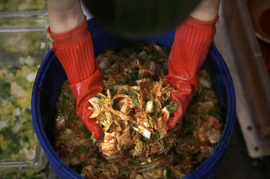 Hyunjoo Albrecht, CEO of Sinto Gourmet, makes fresh kimchi in her San Francisco kitchen. Photo: Liz Hafalia, The Chronicle
