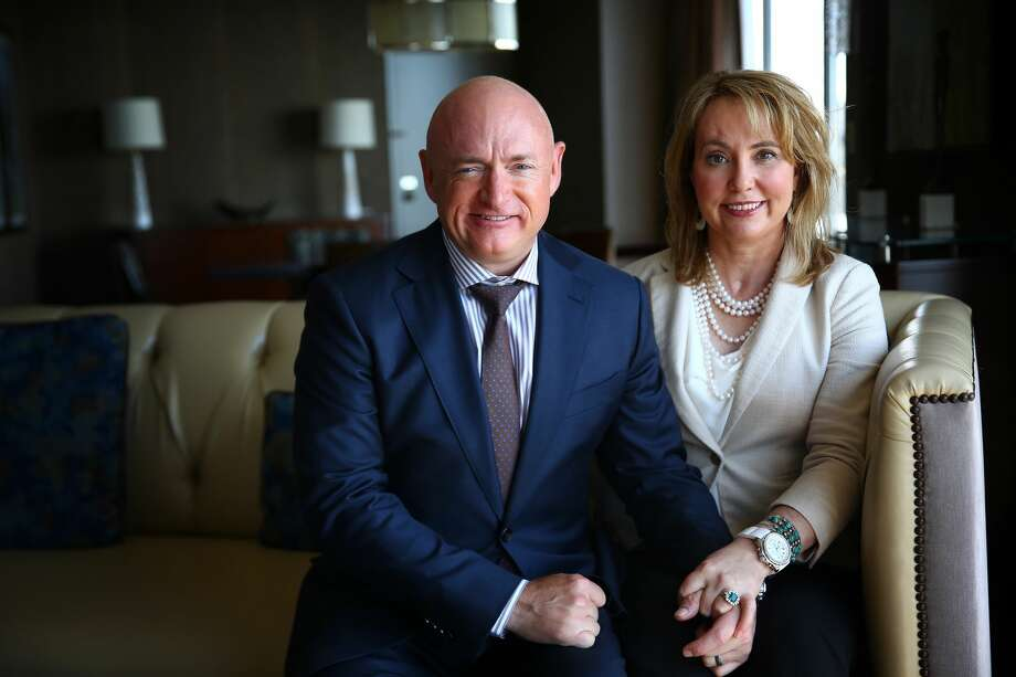 Former Arizona congresswoman Gabrielle Giffords and husband former astronaut Mark Kelly pose for a photo at the Westin Hotel in Seattle, Monday, May 9, 2016.  The outspoken gun reform advocates were attending a  luncheon hosted by the Washington Alliance for Gun Responsibility to raise money for ballot measure I-1491 which would provide for Extreme Risk Protection Orders that allow families and law enforcement to petition the court to temporarily suspend a person's access to firearms if there is evidence they are a threat to themselves or others. Giffords was shot in the head in 2011 during an event in Tuscon.  Despite suffering brain injuries, she and Kelly continue their fight against gun violence across the country.  (Genna Martin, seattlepi.com) Photo: GENNA MARTIN, SEATTLEPI.COM