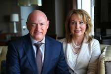 Former Arizona congresswoman Gabrielle Giffords and husband former astronaut Mark Kelly pose for a photo at the Westin Hotel in Seattle, Monday, May 9, 2016. The outspoken gun reform advocates were attending a luncheon hosted by the Washington Alliance for Gun Responsibility to raise money for ballot measure I-1491 which would provide for Extreme Risk Protection Orders that allow families and law enforcement to petition the court to temporarily suspend a person's access to firearms if there is evidence they are a threat to themselves or others. Giffords was shot in the head in 2011 during an event in Tuscon. Despite suffering brain injuries, she and Kelly continue their fight against gun violence across the country. (Genna Martin, seattlepi.com)