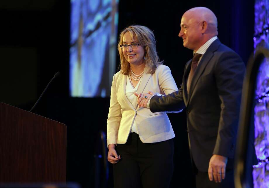 Former U.S. Representative Gabby Giffords and husband Mark Kelly speak at the Washington Alliance for Gun Responsibility's annual luncheon, Monday, May 9, 2016, at the Seattle Westin.  The couple founded Americans for Responsible Solutions, which has given $200,000 to the campaign for Initiative 1491. I-1491 would provide for Extreme Risk Protection Orders that allow families and law enforcement to petition the court to temporarily suspend a person's access to firearms if there is evidence they are a threat to themselves or others.  (Genna Martin, seattlepi.com) Photo: GENNA MARTIN, SEATTLEPI.COM