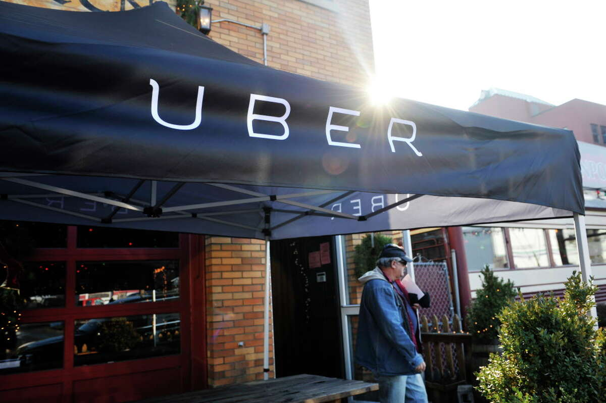 A potential Uber driver leaves Wolff's Biergarten on Thursday, Dec. 10, 2015, in Albany, N.Y. following an Uber information meeting put on by the company. (Paul Buckowski / Times Union)