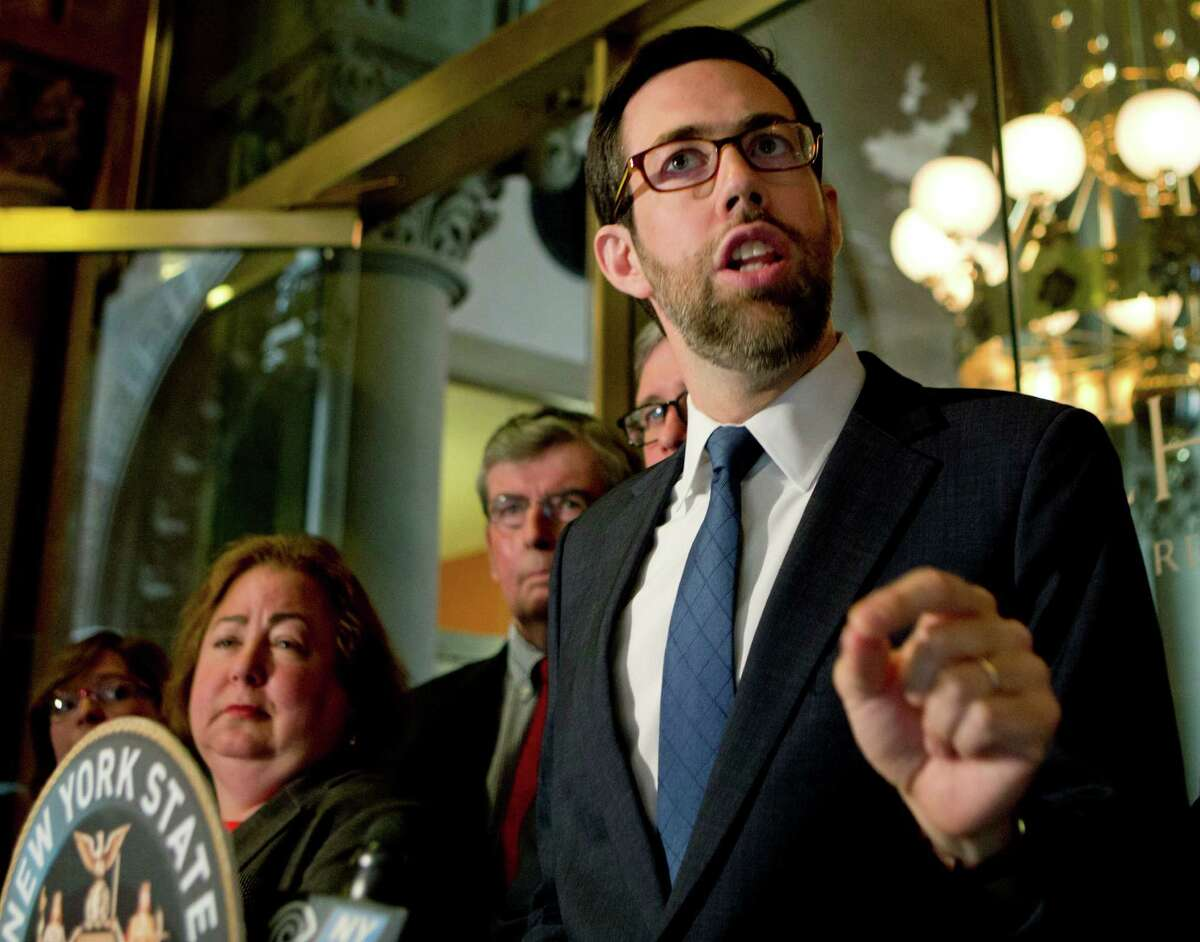 Sen. Daniel Squadron, D-New York, speaks during a news conference at the state Capitol on Monday, May 9, 2016, in Albany, N.Y. The New York Senate Elections Committee has briefly considered legislation to close a campaign finance loophole for limited liability companies, its Republican members voting to send it to another committee. Squadron, the lead sponsor, urged the Elections Committee to send it to a floor vote in the Republican-controlled chamber instead, where all senators would have to publicly show their positions. (AP Photo/Mike Groll)