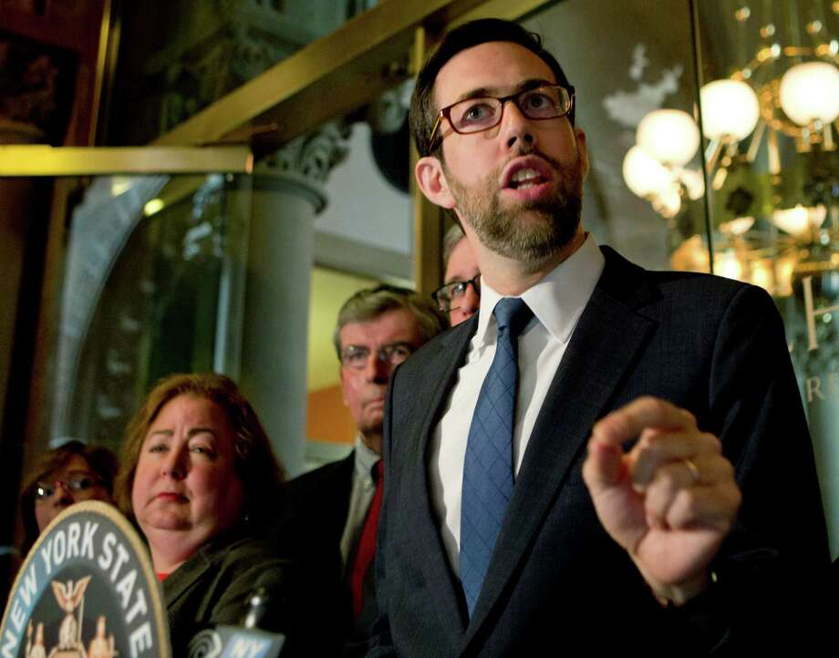 Sen. Daniel Squadron, D-New York, speaks during a news conference at the state Capitol on Monday, May 9, 2016, in Albany, N.Y. The New York Senate Elections Committee has briefly considered legislation to close a campaign finance loophole for limited liability companies, its Republican members voting to send it to another committee. Squadron, the lead sponsor, urged the Elections Committee to send it to a floor vote in the Republican-controlled chamber instead, where all senators would have to publicly show their positions. (AP Photo/Mike Groll) Photo: Mike Groll / Copyright 2016 The Associated Press. All rights reserved. This m