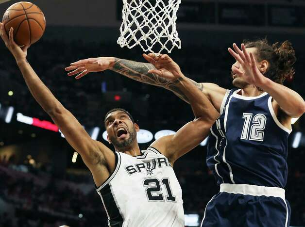 Tim Duncan adds two against Steven Adams as the Spurs host the Thunder in game 1 of second round NBA playoff action at the AT&T Center on April 230, 2016. Photo: TOM REEL, STAFF / SAN ANTONIO EXPRESS-NEWS / 2016 SAN ANTONIO EXPRESS-NEWS