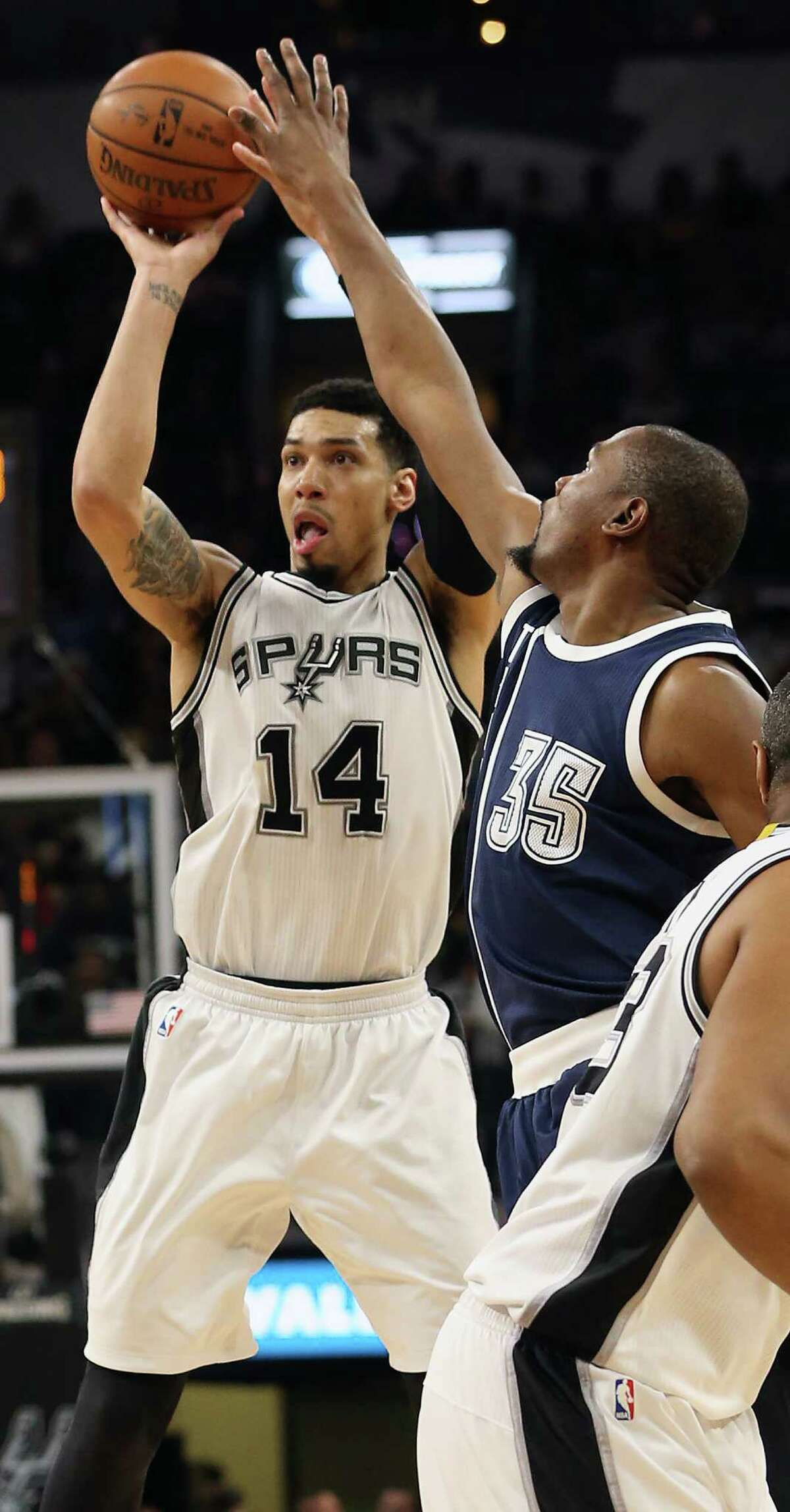 Danny Green pumps a three pointer and is fouled by Kevin Durant as the Spurs host the Thunder in game 1 of second round NBA playoff action at the AT&T Center on April 230, 2016.