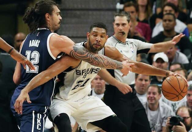 Tim Duncan fights against the defense of Steven Adams as the Spurs host the Thunder in game 1 of second round NBA playoff action at the AT&T Center on April 230, 2016. Photo: TOM REEL, STAFF / SAN ANTONIO EXPRESS-NEWS / 2016 SAN ANTONIO EXPRESS-NEWS